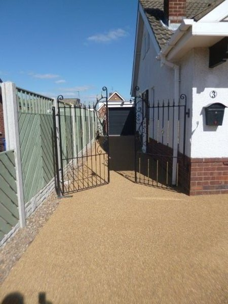 Gated entrance with resin bonded stone in Amber Gold