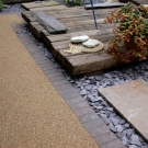 patio design with resin decking and slate