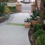 Anti slip resurfacing providing resin aggregate driveway benefits