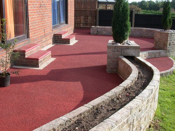 pigmented red resin patio install