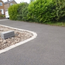 ravenshead resin bonded grey bauxite drive with edged driveway